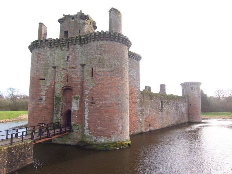 Caerlaverock Castle with drawbridge and moat