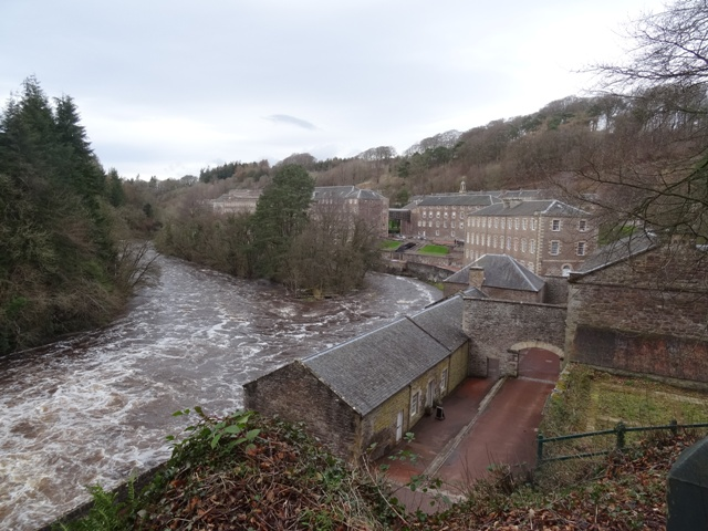 View of New Lanark Mill from banks of River Clyde