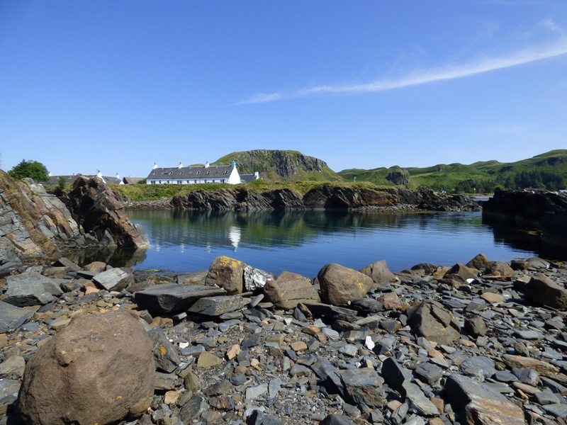 Cottages and an old flooded slate quarry on Easdale