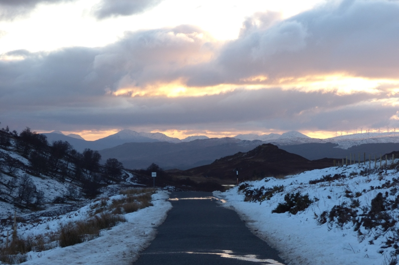 A single track road in Scotland in Winter snow